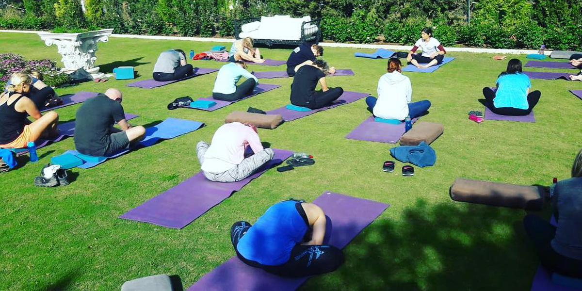 Jane Zimmerman Leading a Yoga Class
